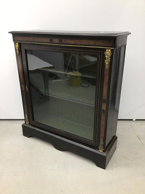 Lot 60 - Victorian ebonised and gilt metal mounted pier cabinet, enclosed by glazed door on shaped plinth, 93cm wide x 29cm deep x 103cm high