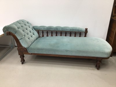 Lot 68 - Victorian mahogany chaise longue, with blue velvet button upholstery on castors