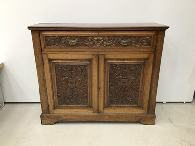Lot 73 - Late Victorian carved walnut cupboard, with frieze drawer and pair of panelled doors belowm carved with mask and scroll ornament, 116 x 36cm deep x 98cm high