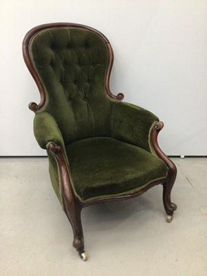 Lot 75 - Victorian mahogany mahogany spoon back armchair, with green button velvet upholstery and showwood frame on cabriole legs and castors