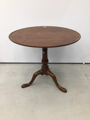Lot 94 - George III mahogany wine table with circular dished top on birdcage mechanism,the baluster turned column with three hipped splayed legs terminating on pad feet.