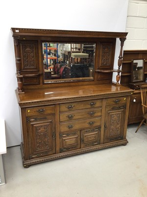 Lot 95 - Edwardian carved oak two height sideboard with mirrored back, Corinthian column supports, drawers and cupboards below.