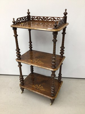 Lot 96 - Victorian inlaid figured walnut three-tier what not with pierced galleried top rail, inlaid foliate marquetry scrolls and parquetry edging on spiral turned supports with original ceramic castors, 5...