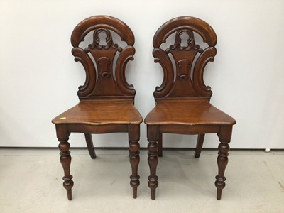 Lot 118 - Pair of early Victorian mahogany hall chairs