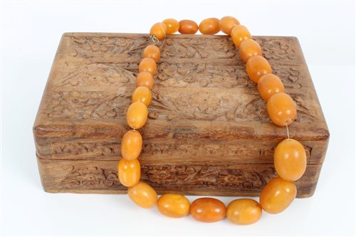 Lot 3384-Vintage amber necklace consisting of a string of...