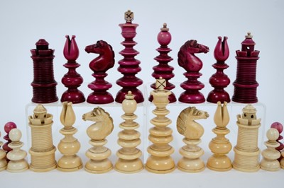 """Lot 829 - Early 19th century, unsigned """"Calvert"""" white and cerise stained ivory chess set, with turned pieces on domed bases, some minor losses, one pawn repaired. King 41/2 inches overall height."""