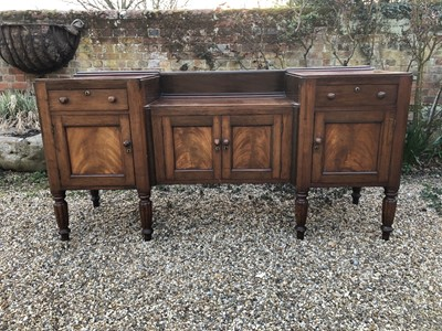 Lot 106 - William IV mahogany sideboard with sunk centre and an arrangement of two drawers and four cupboards, on turned and fluted tapered legs, 192cm wide x 60cm deep x 94cm high