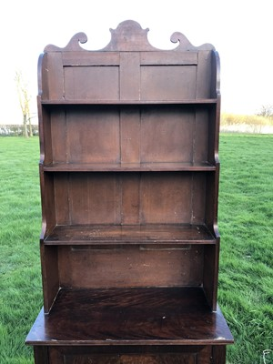 Lot 96 - 19th century mahogany and grained waterfall bookcase with scrolling top rail and graduated open shelves, enclosed panel cupboard below, on tapering legs, 78cm wide x 38cm deep x 190cm high