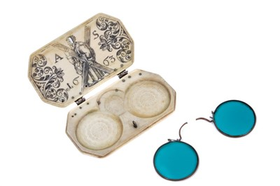 Lot 789 - Rare and fine 17th century carved ivory spectacle case of Scottish importance with pair of period sunglasses .The ivory case of rectangular form with carved roundel decoration and silver hinges and...