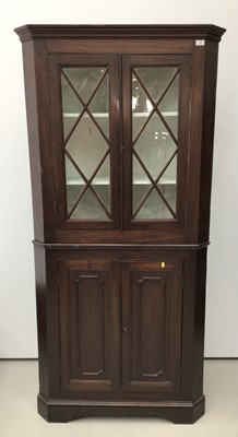 Lot 115 - 19th century mahogany two height corner cupboard, the upper glazed section enclosing shelves, above twin panelled doors, 200cm high x 97cm wide