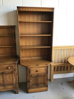 Lot 104 - Ercol elm two height bookcase with three...