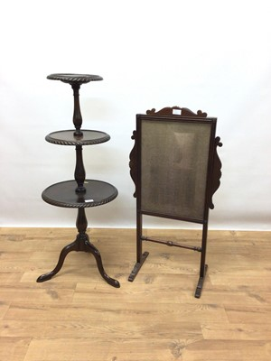 Lot 120 - Good quality mahogany three tier wine table on faceted column and three hipped splayed legs, 104cm high
