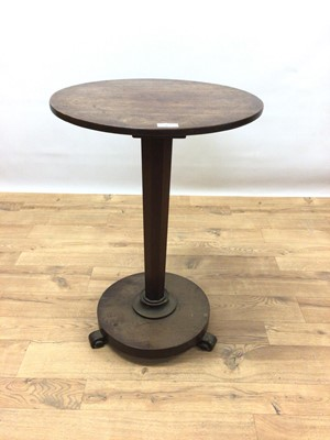 Lot 116 - Nineteenth century mahogany wine table with circular top on faceted column and circular base with scroll feet, 48cm diameter, 69cm high