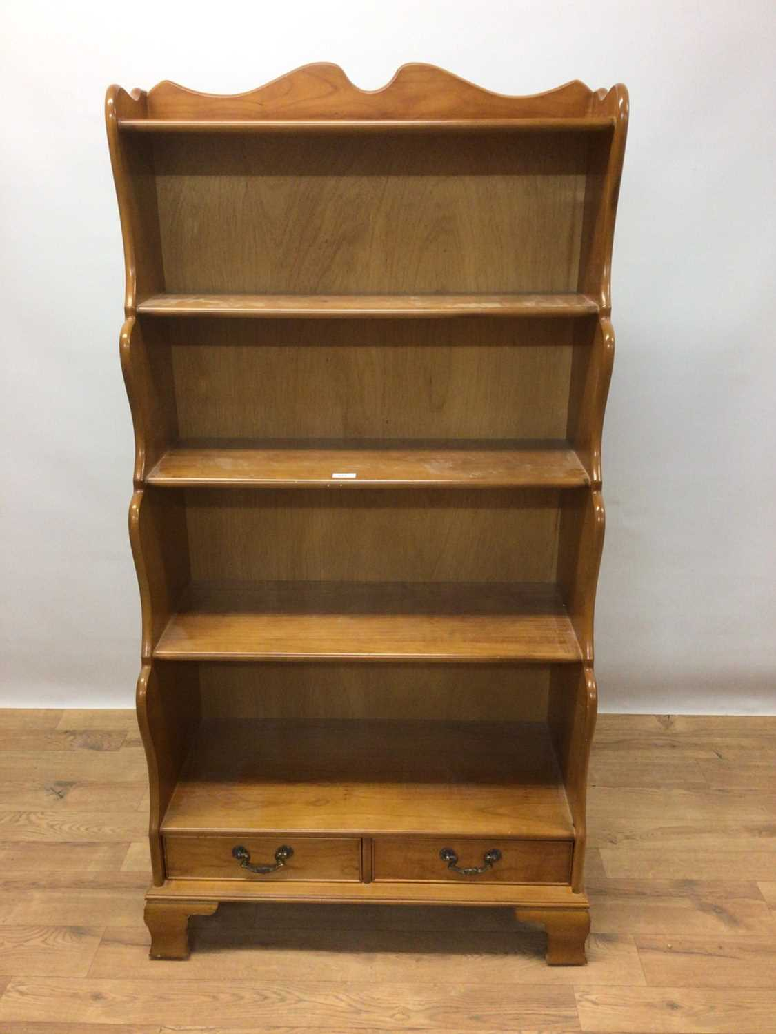 Lot 95 - Pine waterfall bookcase with open shelves and two drawers below, 78cm wide, 38cm deep, 150cm high