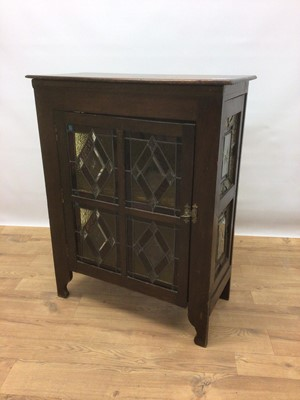 Lot 107 - Early 20th century cabinet with shelved interior enclosed by stained and leaded glazed door, 68cm wide, 32cm deep, 86cm high