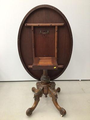 Lot 35 - Victorian inlaid walnut oval loo table
