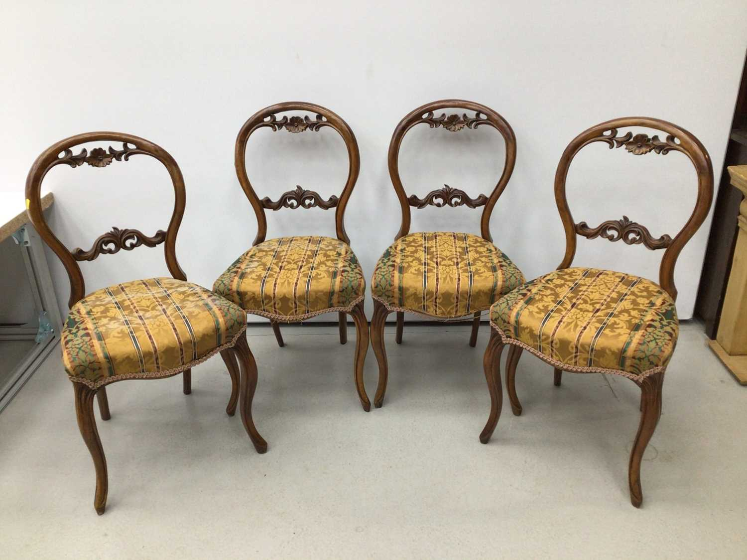 Lot 34 - Set of four Victorian walnut balloon back chairs