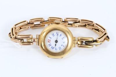 Lot 32 - Ladies' 18ct gold cased wristwatch on expandable bracelet