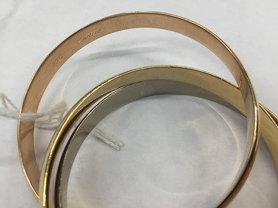 Lot 631 - Cartier Trinity three colour 18ct gold bangle in original box with receipt