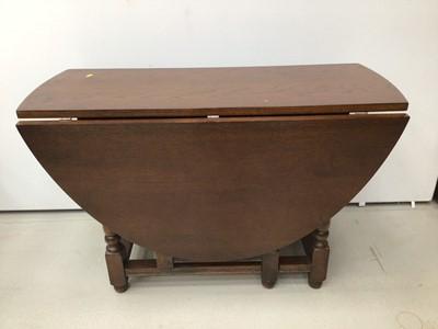 Lot 25 - Oak oval drop leaf dining table and a set of six oak wheelback chairs