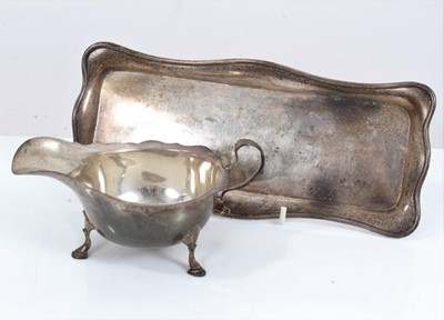 Lot 43 - Silver sauce boat together with a silver pen tray (2)
