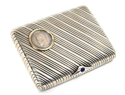 Lot 8 - Fine Imperial Russian silver cigarette case with inset 25 Rubel coin dated 1896 with gold framed mount, slanting ribbed decoration with blue cabochon button , 84 silver mark and Petrograd zolotnik...