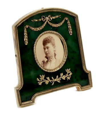 Lot 9 - Fabergé-style silver gilt and green nephrite photograph frame containing an Edwardian portrait photograph of H.R.H. Princess Mary of Wales ( later H.M. Queen Mary) with swag and ribbon decoration,...
