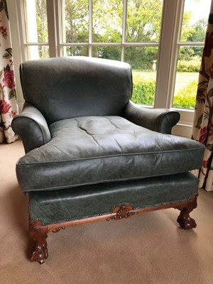 Lot 1415 - Good quality Howard & Sons low armchair, upholstered in blue/green leather with loose seat, on carved cabriole legs and claw and ball feet terminating on brass castors, the rear leg stamped 1238. 2...