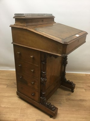 Lot 940 - Victorian walnut Davenport, the leather lined slope front enclosing fitted interior and stationary compartment, four drawers to side and carved and turned supports, on castors, 53cm wide x 54cm dee...