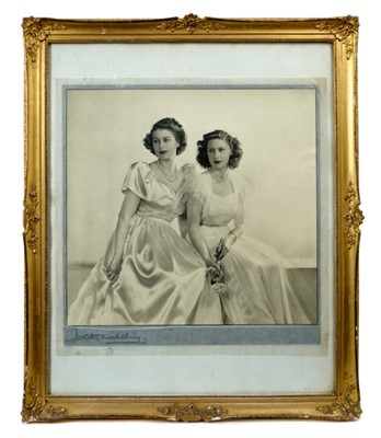 Lot 16 - T.R.H. Princess Elizabeth (Later Queen Elizabeth II) and Princess Margaret , fine black and white portrait photograph by Dorothy Wilding taken 27th May 1946 , signed by the photographer in origin...