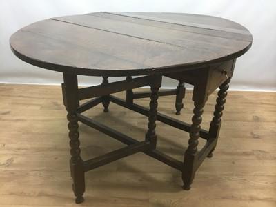 Lot 943 - 17th century oak drop leaf table