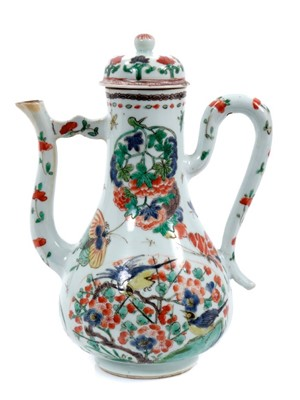 Lot 156 - Chinese famille verte porcelain ewer and cover, Kangxi period, painted with birds, flowers and insects, 21cm high
