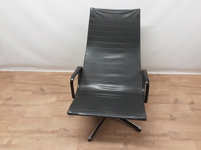 Lot 899 - Vintage aluminium and leather swivel lounge chair in the manner of Charles and Ray Eames
