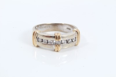 Lot 57 - 9ct white gold seven stone diamond ring