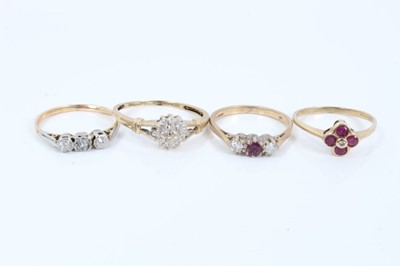 Lot 59 - Four gold diamond and ruby rings