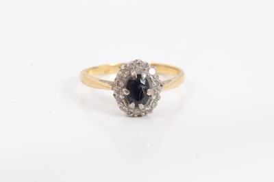 Lot 71 - 18ct gold sapphire and diamond cluster ring, size N