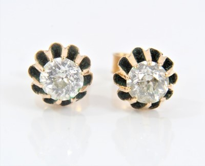 Lot 76 - Pair of antique diamond single stone earrings, each with an old cut diamond estimated to weigh approximately 0.25cts, in gold setting