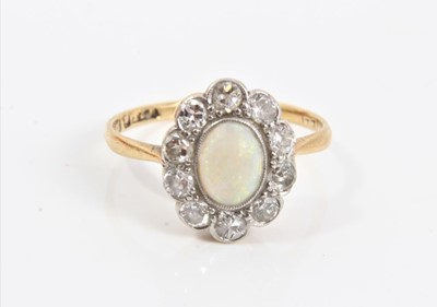 Lot 78 - Edwardian 18ct gold opal and diamond cluster ring in millegrain setting, size K½