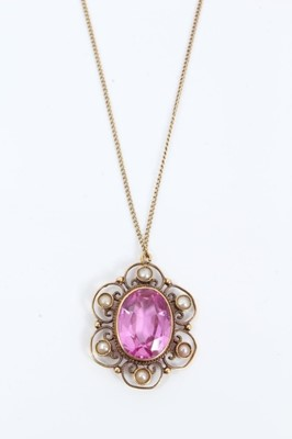 Lot 79 - Early 20th century 18ct gold pink stone and seed pearl pendant with an oval mixed cut pink stone, possibly a pink topaz, mounted in an open work flower shaped setting set with six seed pearls, on 1...