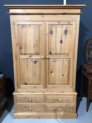 Lot 3 - Modern pine double wardrobe with two panelled doors and four short drawers below, 128cm wide x 63cm deep x 208cm high
