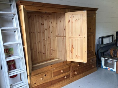 Lot 9 - Modern pine triple wardrobe wiht three panelled doors, three short and two long drawers below, 184cm wide x 59cm deep x 199cm high plus a pine four door wardrobe and a cheval mirror