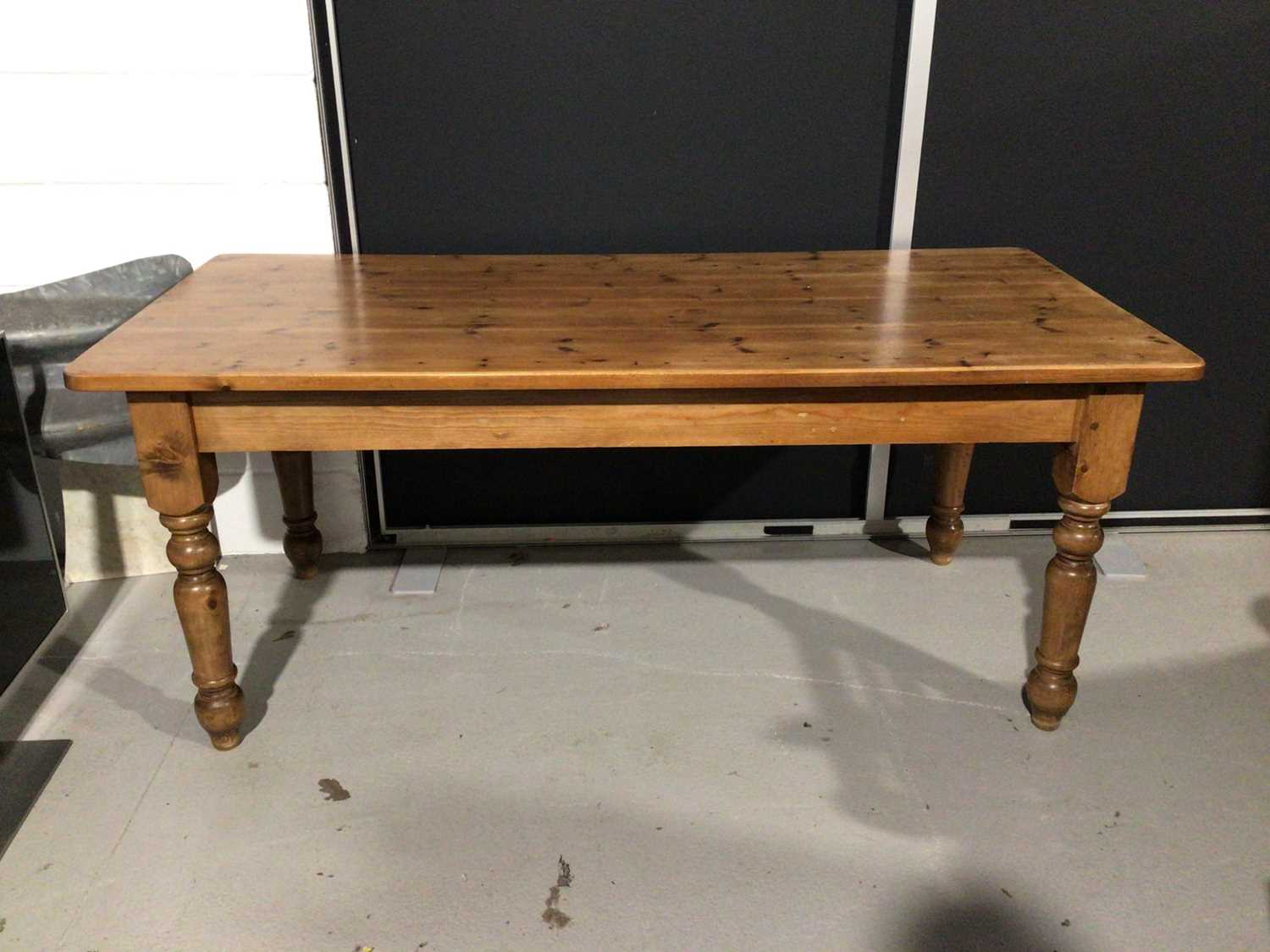 Lot 10 - Pine kitchen table on turned legs, 183cm wide x 85.5cm deep x 76cm high, set of six kitchen chairs comprising five standards and one carver plus a pine two height dresser