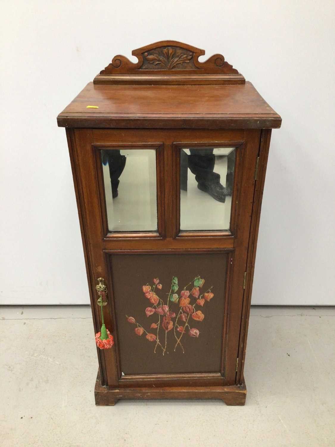 Lot 18 - Edwardian walnut pot cupboard with ledge back, two bevelled mirror plates and painted door below, 45.5cm wide x 34cm deep x 100cm high