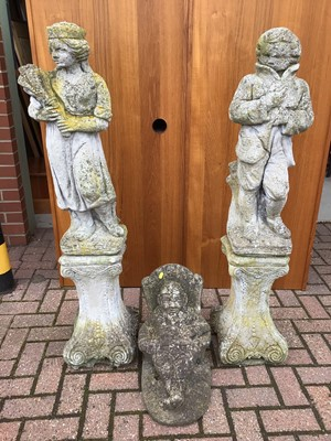 Lot 51 - Pair of concrete figures on stands 126cm and 123cm and one other of a seated gnome 40cm