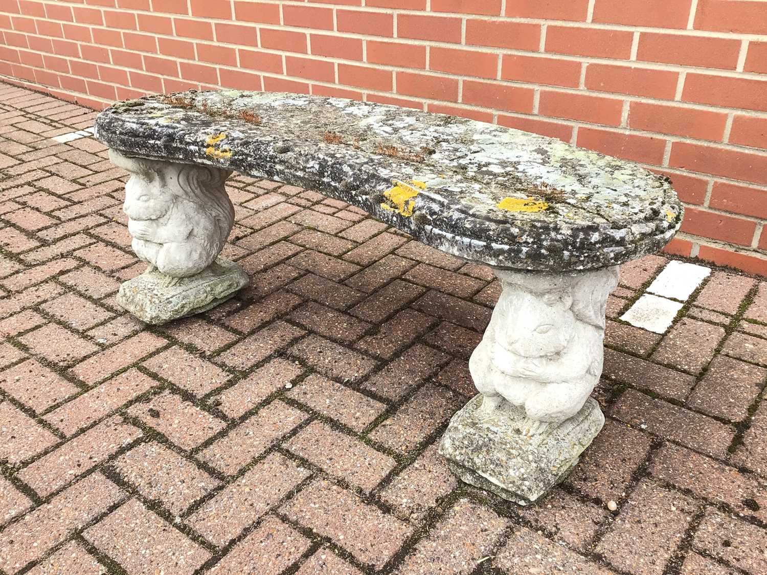 Lot 53 - Concrete garden bench with squirrel supports 111cm x 46cm