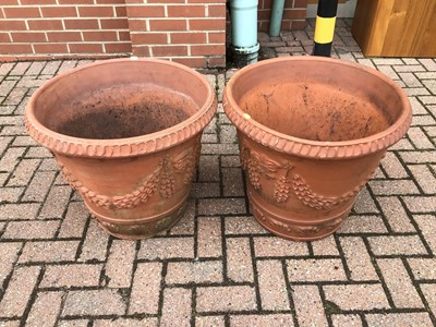Lot 54 - Pair of large terracotta garden urns with wreath decoration 51cm x 58cm