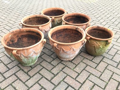 Lot 55 - Five similar terracotta garden urns with swag decorations approx 39cm height x 47cm diameter and a similar smaller terracotta urn 35cm height x 37cm diameter