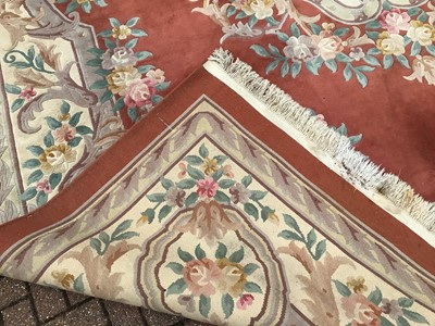 Lot 60 - Large Chinese was rug with floral decoration on terracotta and cream ground 367cm x 470cm