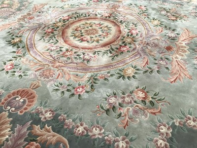 Lot 61 - Large Chinese rug with floral decoration on green and cream ground 369cm x 463cm
