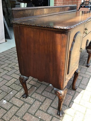 Lot 62 - Good quality walnut sideboard with raised ledge back, two central drawers below flanked by cupboards on carved cabriol legs 183cm wide x 58cm deep x 110cm high